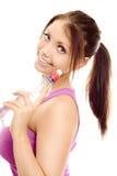 De vrouw van de sport met de glimlach van het flessenwater Stock Afbeeldingen