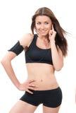 De vrouw van de sport na aanstotende training Stock Fotografie