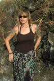 De vrouw van de tatoegering in sarongen Stock Foto