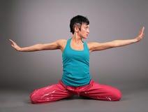De vrouw van de yoga in sportkleding Stock Foto's