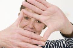 De vrouw van het handkader oler het glimlachen Stock Foto