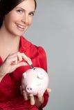 De Vrouw van het Muntstuk van het spaarvarken Stock Foto's