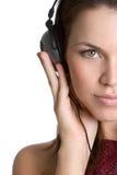 De Vrouw van hoofdtelefoons stock foto's