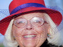 De Vrouw van Red Hat Stock Foto's