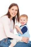 De vrouw van Smiley en joyous baby Royalty-vrije Stock Afbeeldingen
