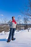 De vrouw van Snowshoeing Stock Foto's