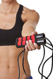 De Vrouw van sporten met touwtjespringen Stock Foto's