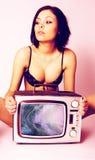 De vrouw van TV Stock Foto's
