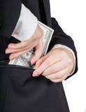 De vrouw zet geld in uw zak Stock Afbeelding