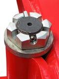 De vrouwelijke geïsoleerdeg schroef van Turnet en rood metaal, Stock Fotografie