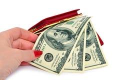 De vrouwelijke hand neemt de dollarrekening Royalty-vrije Stock Fotografie