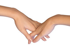 De vrouwelijke hand raakt een andere hand door hun vingers te doorweven Royalty-vrije Stock Foto