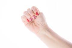 De vrouwelijke hand toont nagellak op een wit Royalty-vrije Stock Fotografie
