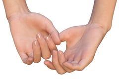 De vrouwelijke handen houden elkaar door de duim Stock Foto's