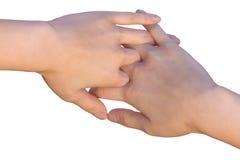 De vrouwelijke handen raken met doorweven vingers Royalty-vrije Stock Afbeeldingen