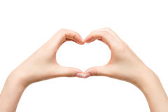 De vrouwelijke handen tonen hart op witte achtergrond Stock Afbeeldingen
