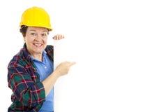De vrouwelijke Punten van de Arbeider bij Teken Royalty-vrije Stock Afbeelding