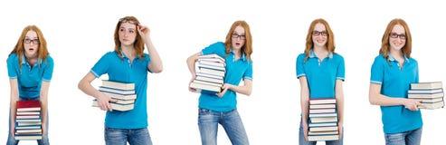 De vrouwelijke student met vele die boeken op wit wordt geïsoleerd stock fotografie