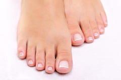 De vrouwelijke voeten van de schoonheid stock fotografie