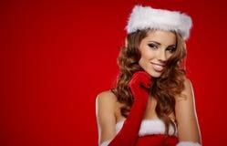 De vrouwen van de kerstman met zakken Stock Foto