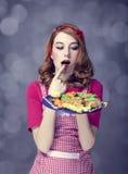 De vrouwen van de roodharige met koekjes Stock Foto