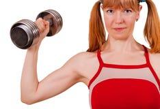 De vrouwen werken bicepsen uit royalty-vrije stock afbeeldingen