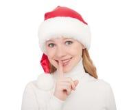 De vrouwengeheim van Kerstmis in een hoed die op wit wordt geïsoleerde royalty-vrije stock foto