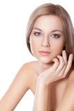 De vrouwengezicht van Beautyful met hand Stock Foto's