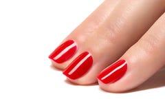 De vrouwenhanden met manicured rode spijkersclose-up. royalty-vrije stock fotografie