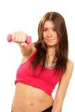 De vrouweninstructeur van de geschiktheid op de domoren van dieetgewichten Stock Foto's