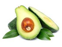 De vruchten van de avocado besnoeiing met blad die op wit wordt geïsoleerdo royalty-vrije stock fotografie