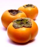 De Vruchten van de Dadelpruim van de boom (kaki Diospyros) Royalty-vrije Stock Fotografie