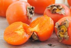 De vruchten van het Kaki van dadelpruimen Stock Fotografie