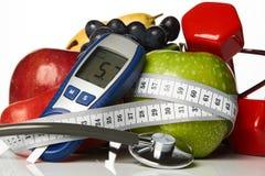 De vruchten van stethoscoopglucometer en domoren, Diabetesconcept Royalty-vrije Stock Foto