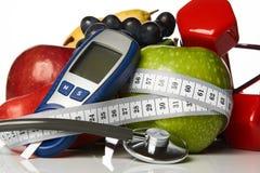 De vruchten van stethoscoopglucometer en domoren, Diabetesconcept Royalty-vrije Stock Afbeeldingen