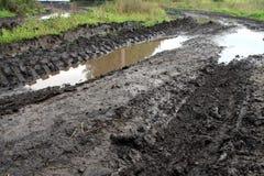 De vuile weg van de modder Royalty-vrije Stock Afbeeldingen
