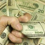 De vuist van het geld Stock Afbeeldingen