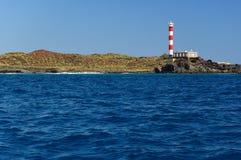 De vuurtoren op een zuidenkust van het eiland van Tenerife stock afbeeldingen
