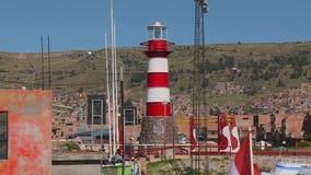 De Vuurtoren van de Punohaven, Meer Titicaca, Peru stock video