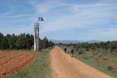 De wandelende pelgrims van Caminofrances Stock Foto's