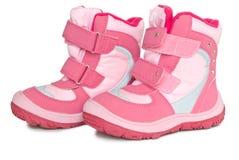 De warme laarzen van het roze jonge geitje. stock fotografie