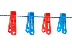 De wasknijpers hangen op een koord Royalty-vrije Stock Foto