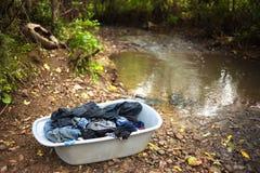 De waswasserij van de rivier Stock Foto