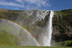 De waterval en de regenboog van IJsland Stock Foto