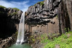 De waterval van het basalt background_Svartifoss Royalty-vrije Stock Foto's