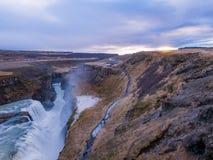 De waterval van IJsland Gulfoss in zonsondergang Stock Foto's