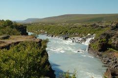 De watervallen van Hraunfossar Stock Foto