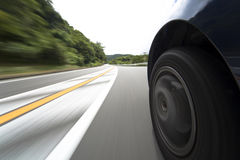 De weg en het wiel van de snelheid Royalty-vrije Stock Afbeelding