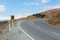 De weg van de kromme aan de heuvel Stock Foto's