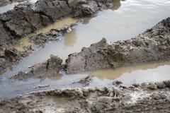 De weg van de modder Stock Afbeeldingen